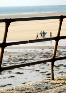 Surfers through the railings